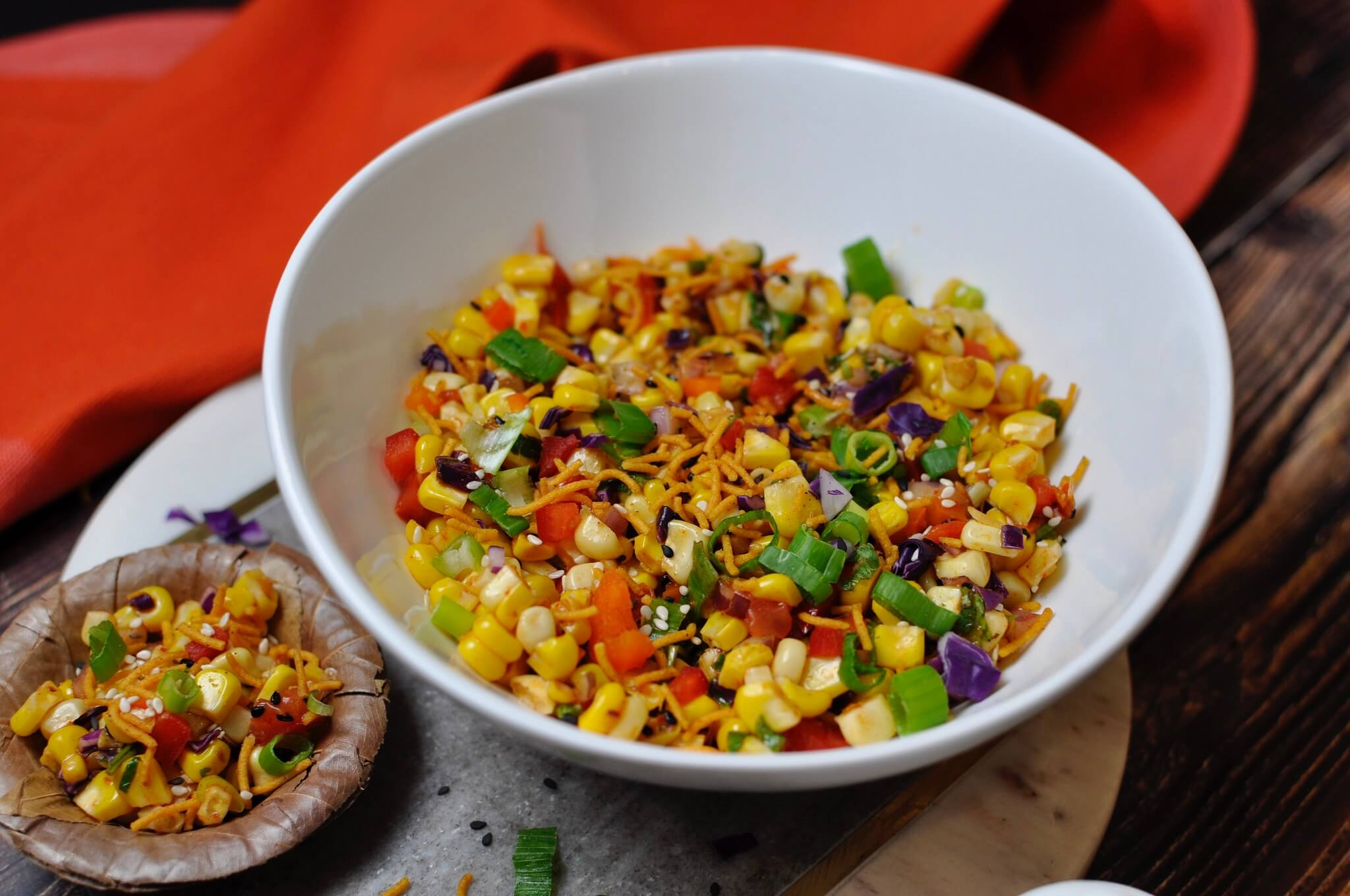 With warm corn, spicy masala, and crunchy vegetables, this Asian Corn Bhel checks off all of the boxes! Perfect as a Friday evening snack or quick appetizer, it's hard to beat that signature Indo-Chinese flavor!