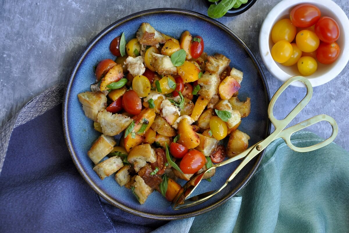 With fresh Georgia peaches, toasty bread, mozzarella, and balsamic, this Italian Peach Panzanella is the perfect warm salad!