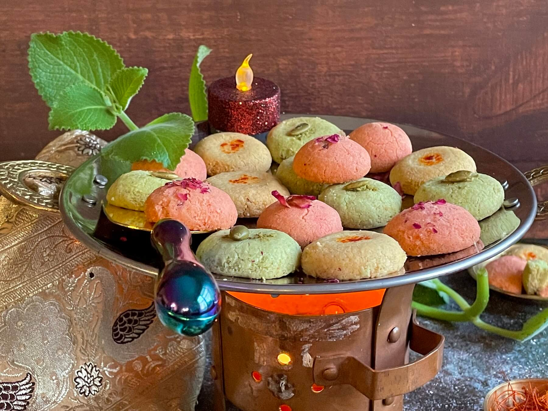 Flavored with rose, pistachio and saffron-cardamom, these Nankhatais are a simple, yet elegant dessert for this upcoming festive season! These beautiful cookies with three different flavors are a memorable twist on traditional sweets that your family is sure to love for Diwali!