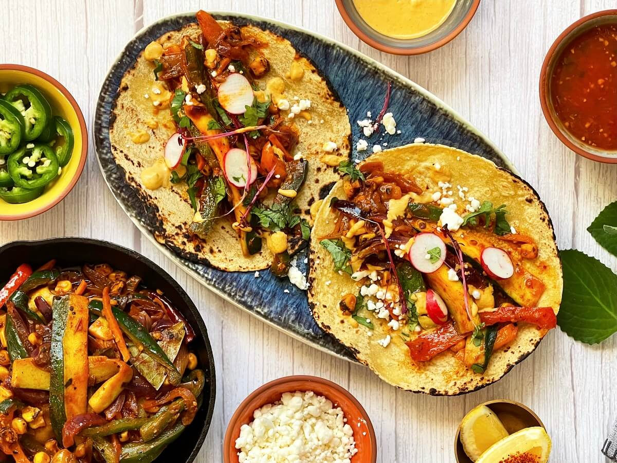 Veggie Fajitas - Super fresh and colorful, these smoky vegetarian fajitas are packing some serious flavor. Pair them with some warm corn tortillas and avocado crema, and enjoy the easiest, most comforting weeknight meal!